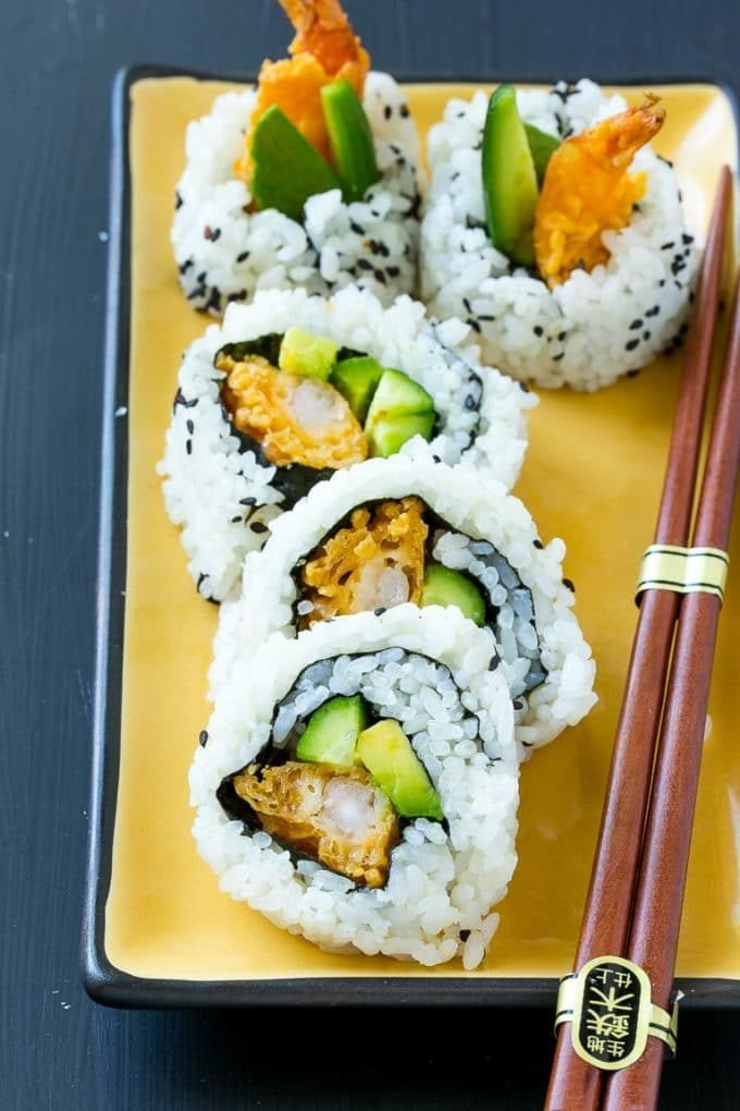 A serving of shrimp tempura roll sushi made with cucumber, avocado and shrimp.