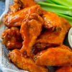Baked buffalo wings tossed in hot sauce, served with celery sticks.