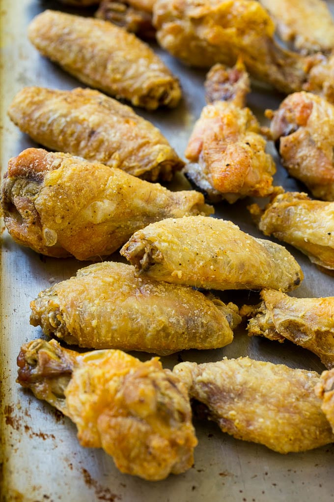 Crispy baked chicken wings on a sheet pan.