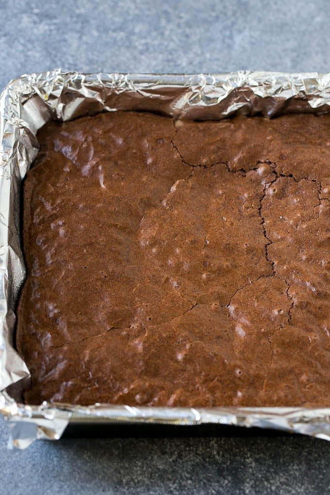 Baked brownies in a square pan.