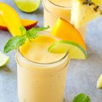 This tropical smoothie recipe is a blend of tropical fruit and coconut milk - it's cool, refreshing and packed with flavor and nutrients!