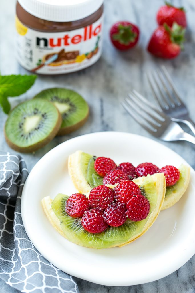 Have fun with your breakfast and turn regular old toaster waffles into watermelon designs with Nutella and fresh fruit! AD