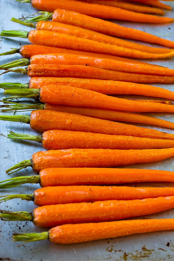 Roasted honey carrots on a sheet pan.