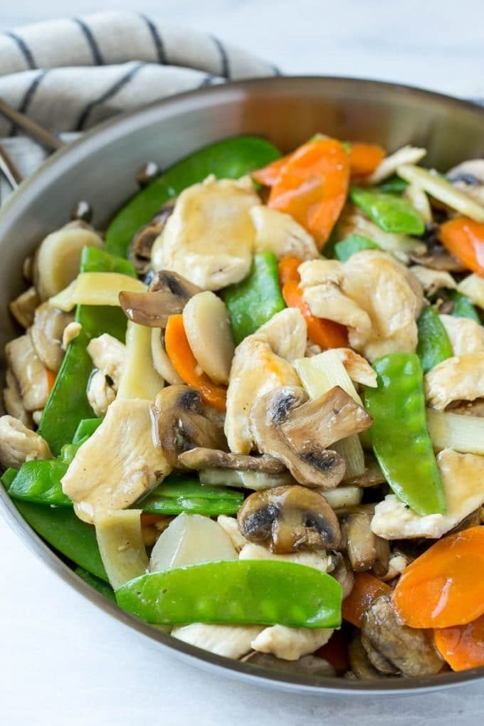 Chicken, mushrooms, snow peas and carrots in a savory sauce.
