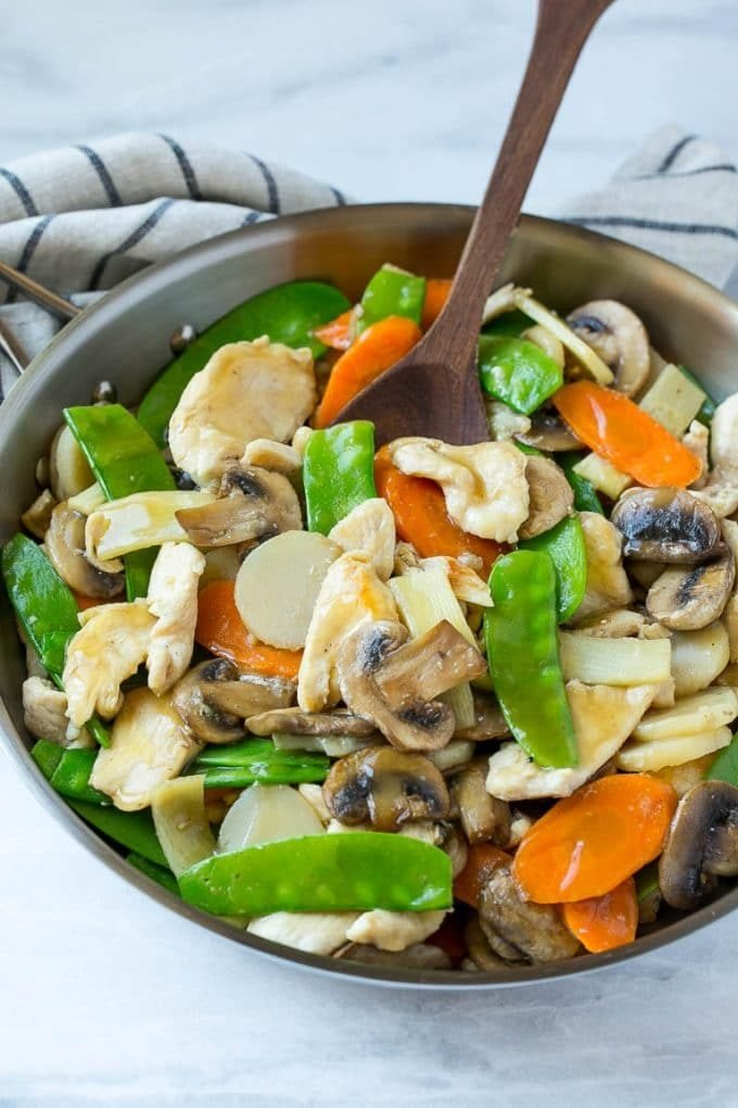 Moo goo gai pan with chicken and vegetables in a skillet.