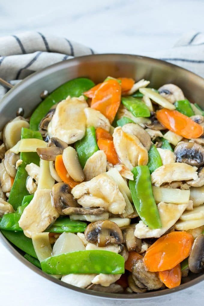 Chicken, vegetable and mushroom stir fry in a pan.