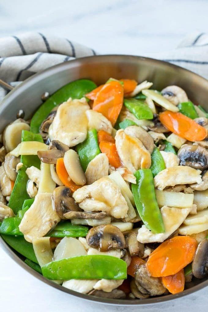 Chicken, vegetable and mushroom stir fry in a pan.