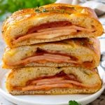 A stromboli recipe with pepperoni, ham and cheese wrapped up in pizza dough and baked.