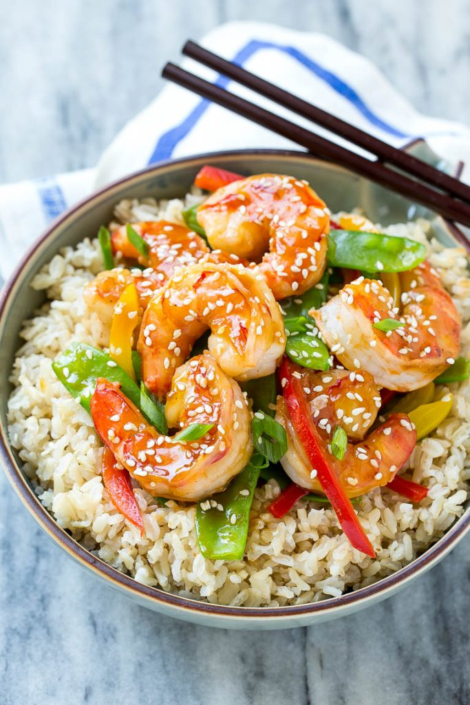 Shrimp stir fry with veggies served over brown rice.