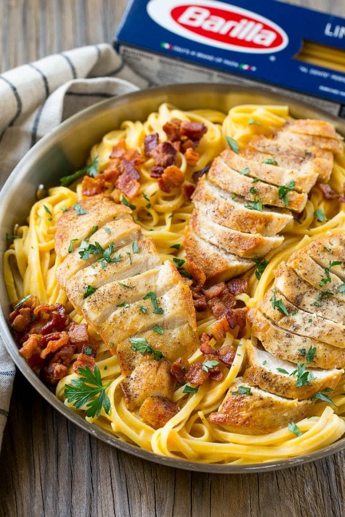 A skillet of linguine pasta tossed with butternut squash sauce.
