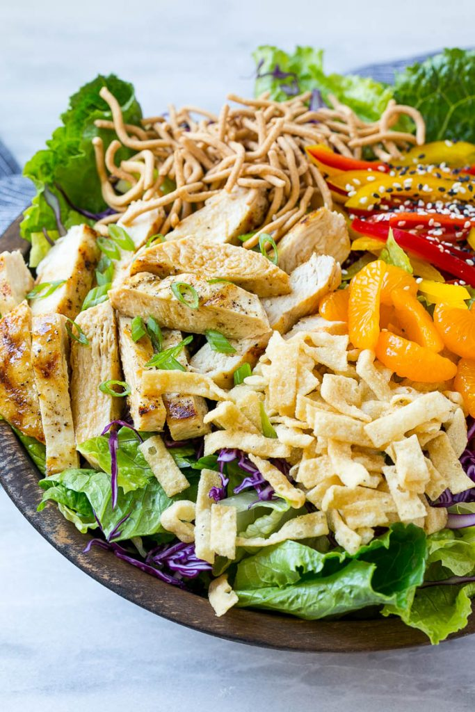 This recipe for Chinese chicken salad is loaded with chicken, veggies, won tons and mandarin oranges, all tossed in a sesame ginger dressing. My all time favorite salad!