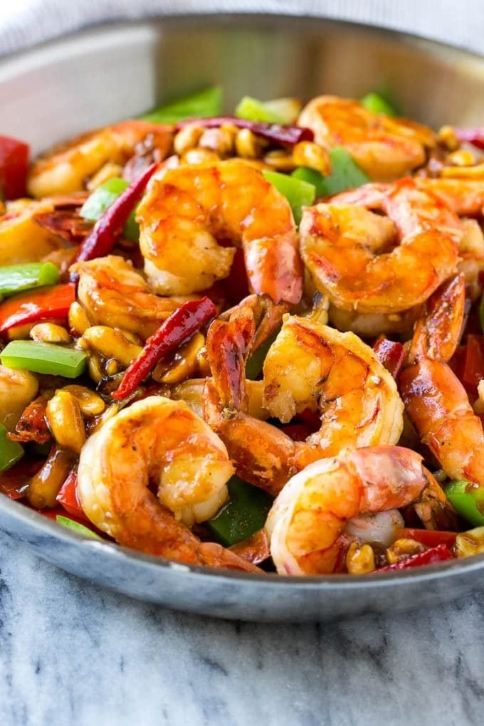 Kung Pao shrimp with bell peppers, peanuts and chilies.