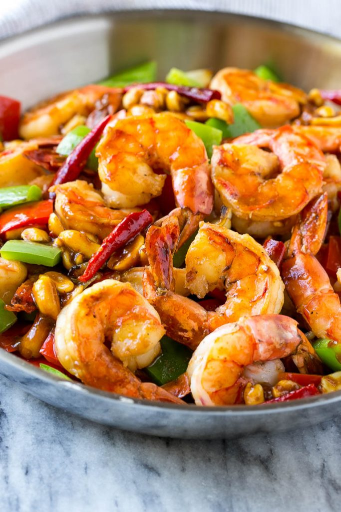 This recipe for Kung Pao shrimp is veggies, peanuts and plenty of shrimp, cooked in a savory and spicy sauce. Make your own take out in just 20 minutes!