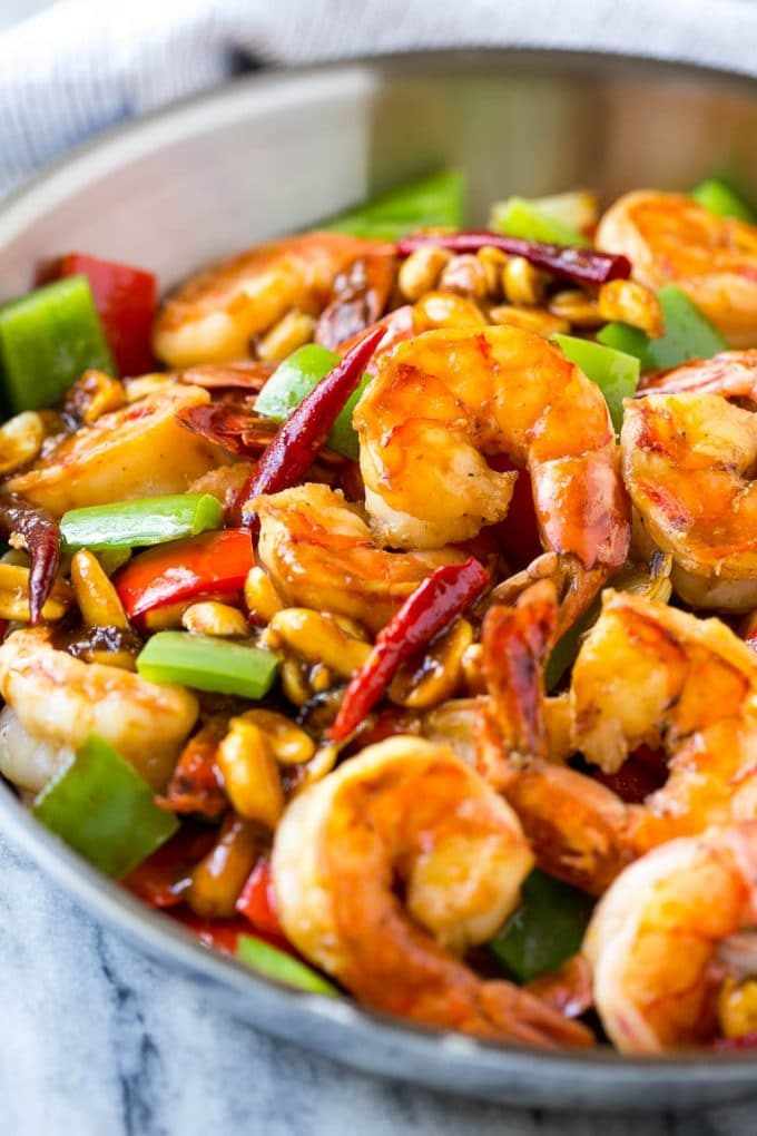 Shrimp in a savory and spicy sauce in a metal pan.