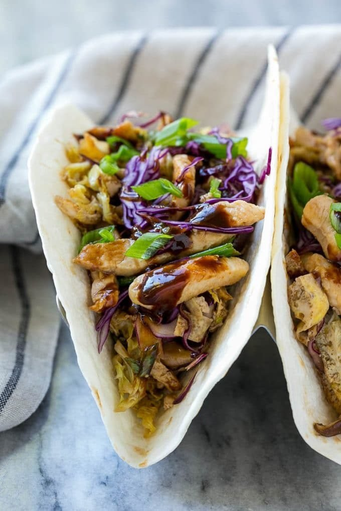 Tortillas filled with moo shu chicken and hoisin sauce.