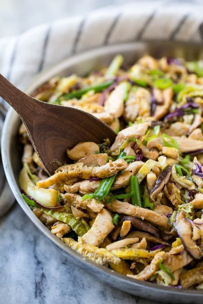 Moo shu chicken in a skillet with vegetables.