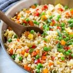 This recipe for veggie fried rice is chock full of colorful veggies and is ready in just 20 minutes! This vegetarian fried rice is the perfect quick and easy side dish that the whole family will love. #WokWednesday #sponsored