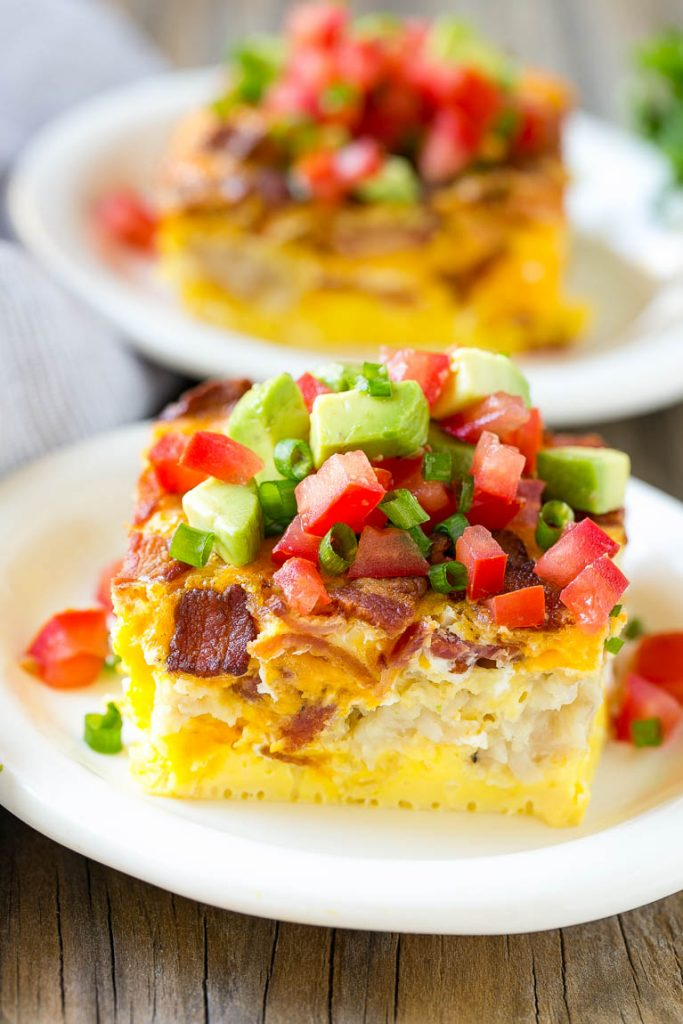This breakfast casserole with bacon recipe is loaded with eggs, cheese and bacon, then finished off with an avocado and tomato topping. The perfect hearty breakfast for any occasion!