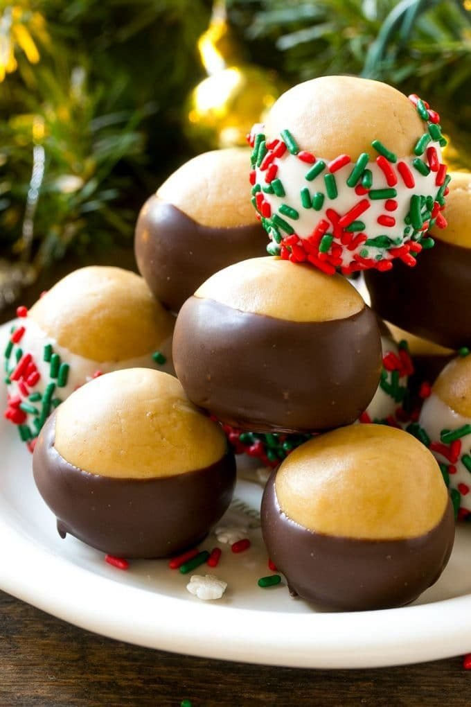 Buckeye balls dipped in dark and white chocolate with sprinkles.