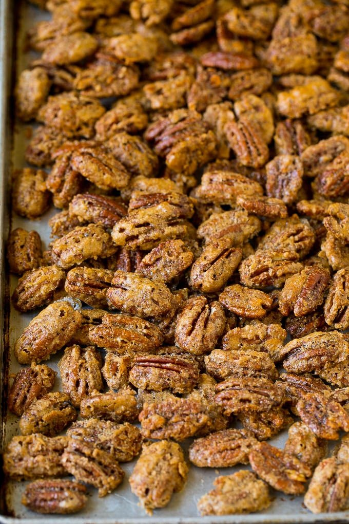 Cooked glazed pecans on a sheet pan.