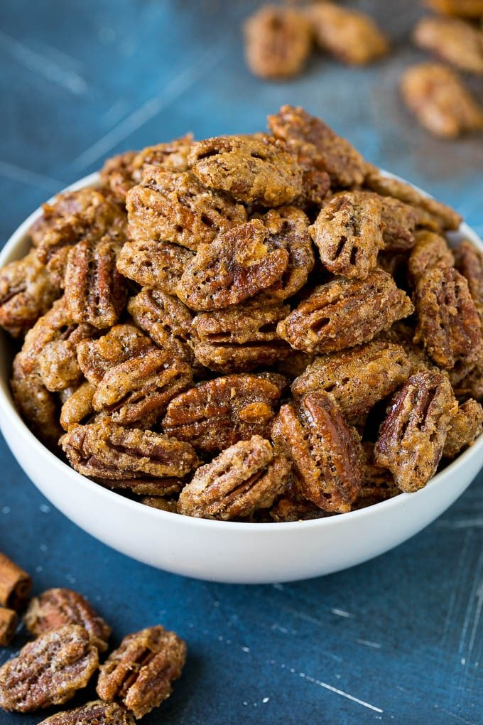 A bowl filled with homemade candied pecans.