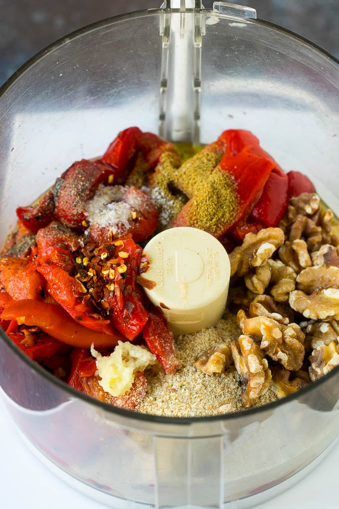 Roasted red peppers, walnuts, spices, olive oil and breadcrumbs in a food processor.