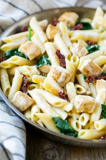 This recipe for sun dried tomato pasta is penne pasta with sauteed chicken and spinach, tossed in a creamy garlic sauce. An easy dinner that the whole family will love!