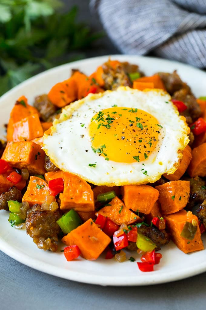 Sweet potato hash with sausage, topped with a fried egg.