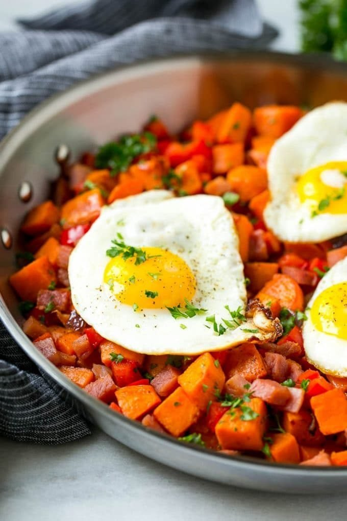 Fried eggs served over sweet potato hash.