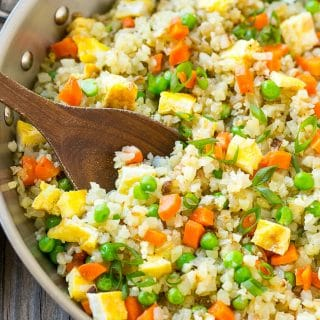 This cauliflower fried rice has all the flavors of your favorite take out dish, but without the carbs; the perfect healthier side dish!