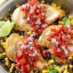 This Salsa Chicken recipe is chicken breasts covered in homemade salsa and served over black beans and corn. It's an easy and healthy dinner that only uses one pan!