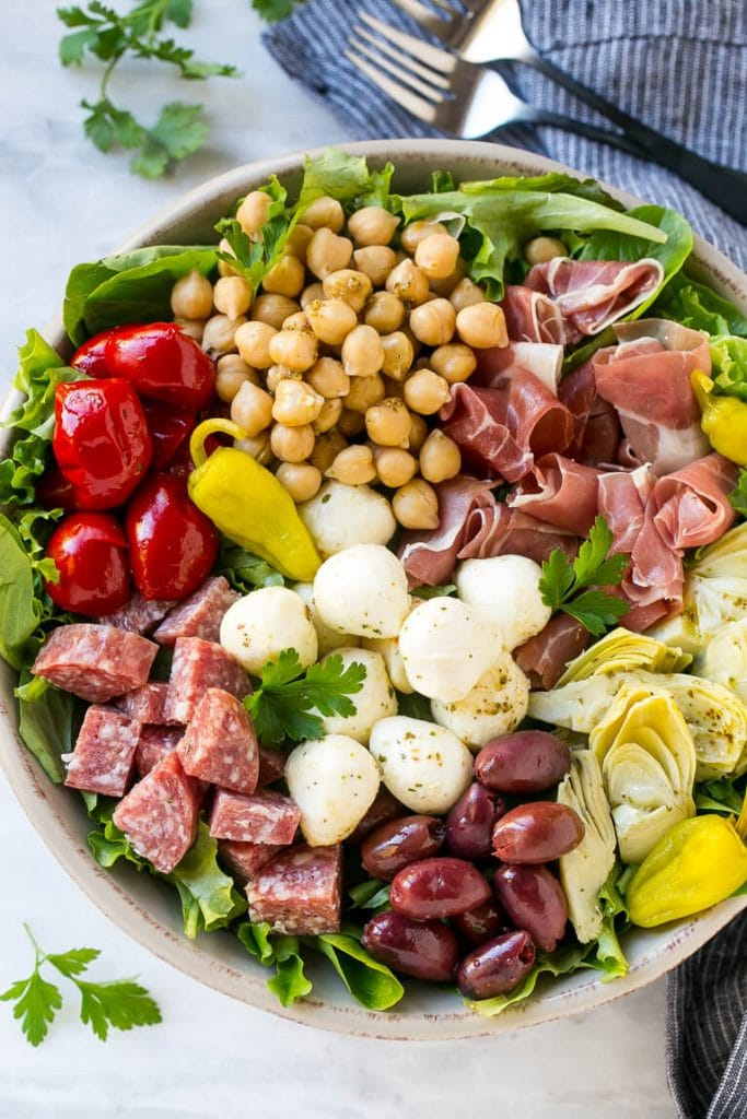 Antipasto salad made with salami, peppers, prosciutto, chickpeas and mozzarella.