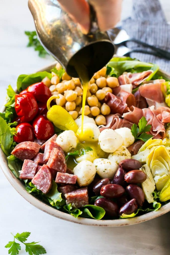 This recipe for antipasto salad is loaded with Italian meats, cheese and veggies, all tossed in a homemade zesty dressing.