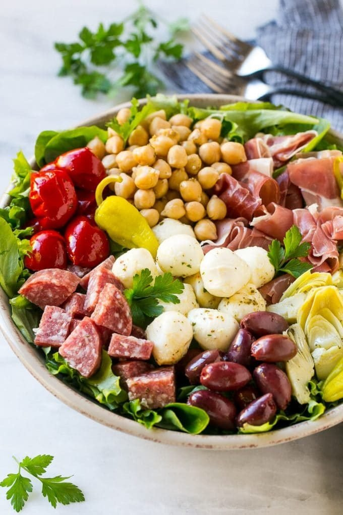 Antipasto salad with cured meats, fresh mozzarella cheese and roasted peppers over salad greens.