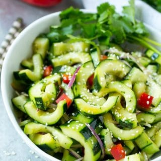 This recipe for Asian cucumber salad is cucumbers and colorful veggies tossed in a zesty sesame dressing. The perfect quick and easy side dish!