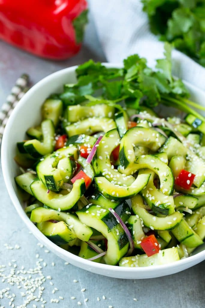 This recipe for Asian cucumber salad is cucumbers and colorful veggies ...