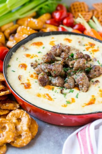This Wisconsin Brat & Beer Cheese Dip is creamy, cheesy and loaded with bratwurst. It's a hearty appetizer that's perfect for game day entertaining!