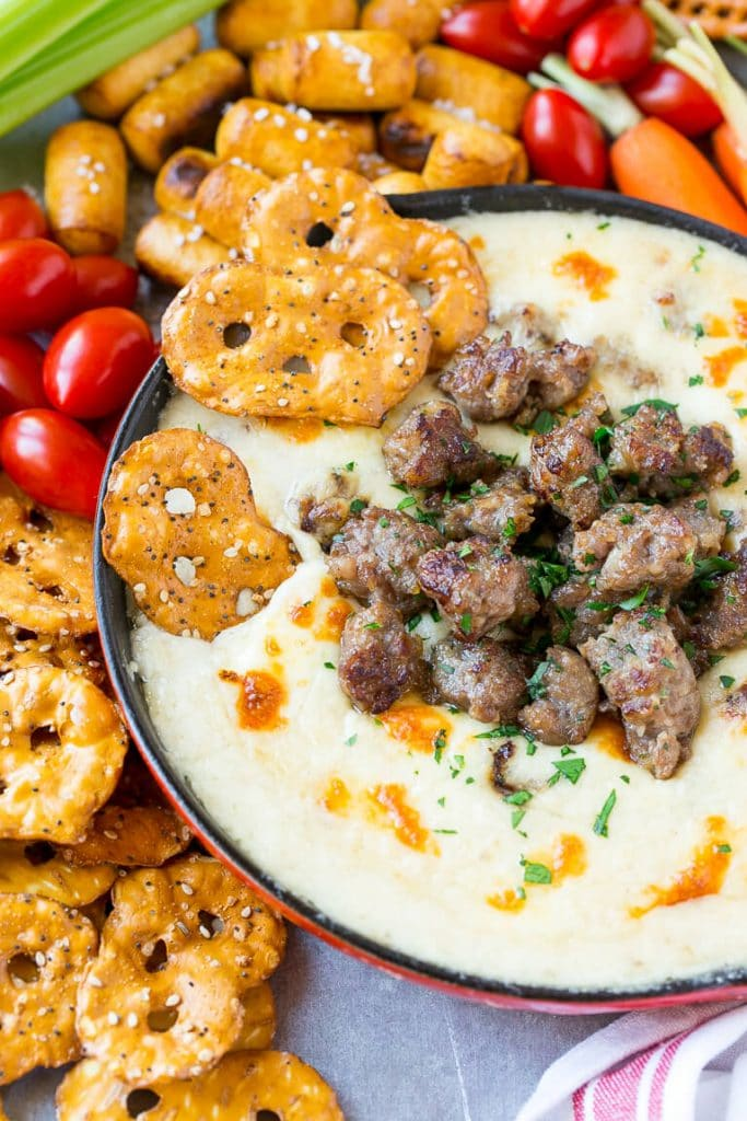 This Wisconsin Brat & Beer Cheese Dip is creamy, cheesy and loaded with bratwurst. It's a hearty appetizer that's perfect for game day entertaining! AD