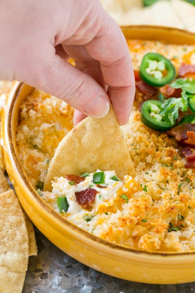 This jalapeno popper dip is creamy, cheesy, spicy, loaded with bacon and totally addicting! Serve it with tortilla chips for the ultimate party snack.