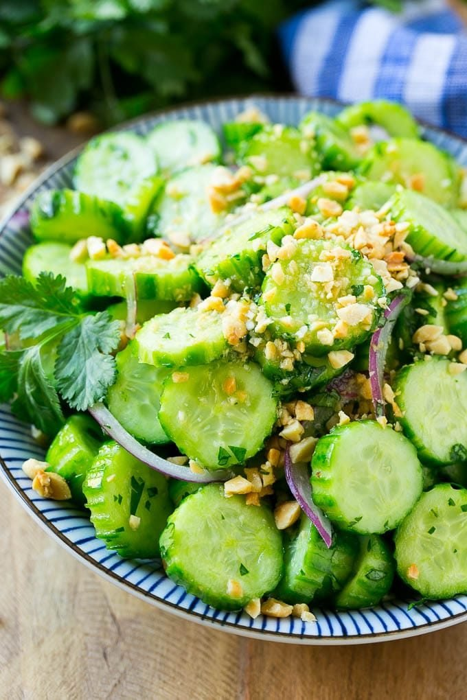 Thai Cucumber Salad made with sliced cucumbers and peanuts in a sweet and savory dressing.