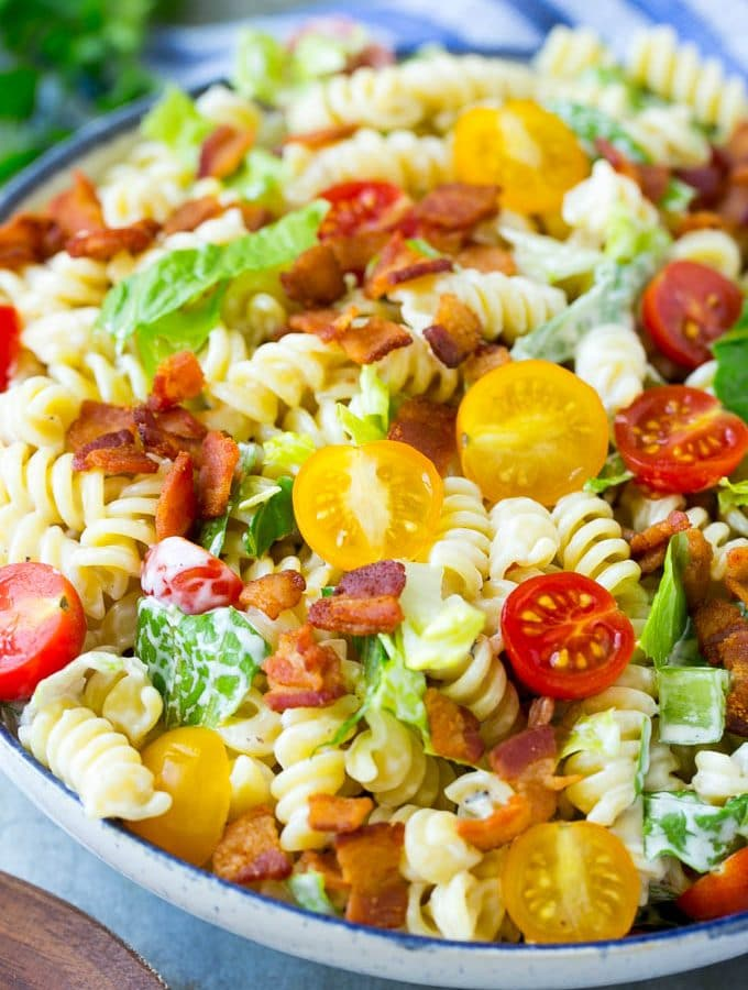 This BLT pasta salad recipe is full of veggies, pasta and crispy bacon, all tossed in a cool and creamy dressing. The perfect easy meal or side dish!