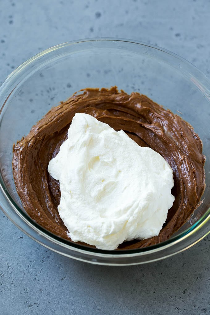 Whipped cream to be folded into chocolate fruit dip.