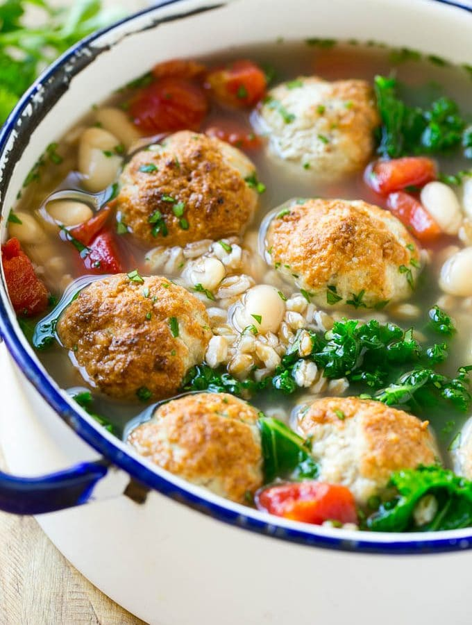 This hearty farro soup recipe is filled with turkey meatballs, white beans and kale. It's the perfect easy and nutritious dinner option!