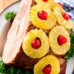 This ham with pineapple and cherries is a classic recipe with one secret ingredient that really takes it over the top. The ULTIMATE holiday ham!