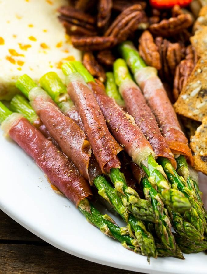 This prosciutto wrapped asparagus is an easy 4 ingredient recipe that's the perfect addition to any appetizer platter!