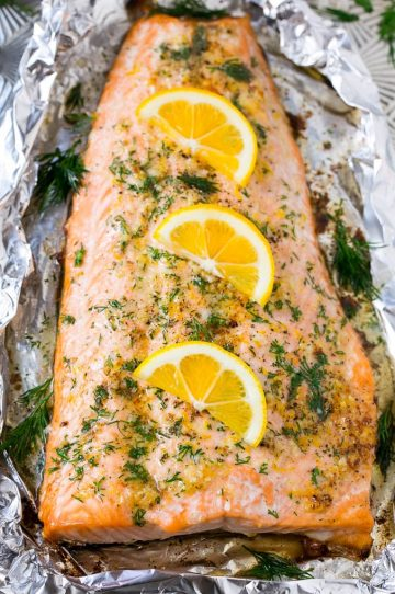 This recipe for salmon in foil is the easiest and most delicious way to eat fish! Salmon is flavored with lemon garlic butter, baked in foil, then topped with fresh dill. The perfect meal for any occasion!