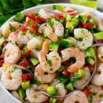 A bowl of shrimp ceviche marinated in citrus juice with tomato, avocado, cilantro and jalapeno.