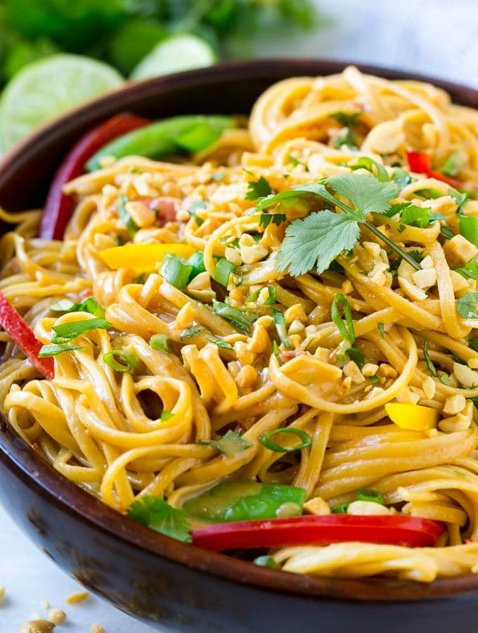 This recipe for Thai peanut noodles is full of colorful veggies and tossed in an easy homemade peanut sauce. No need for take out when you can make your own in just 20 minutes!