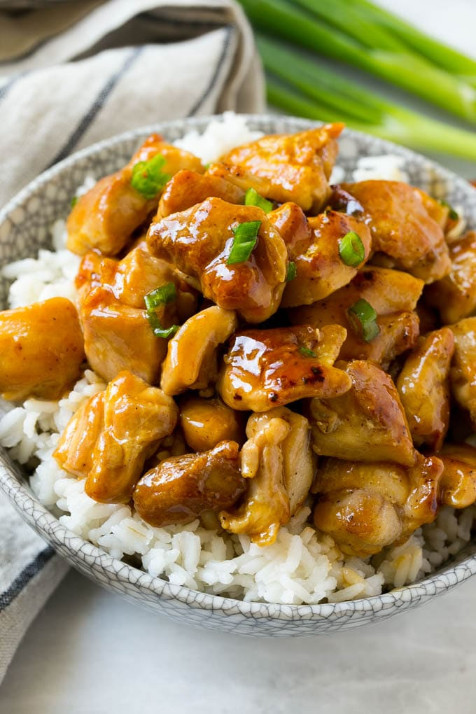 Bourbon chicken served over a bowl of rice.