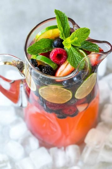 This berry champagne punch recipe is festive, refreshing and super easy to make! It's the perfect cocktail for any summer party.